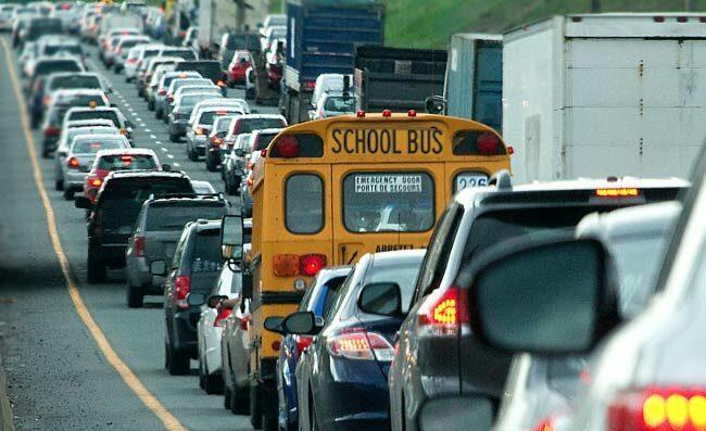school bus driving-in-heavy-traffic