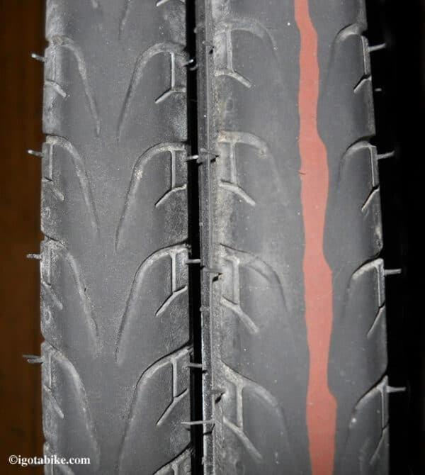 The tire has tiny slits that help their grip on wet surfaces—is disappearing it is time for a replacement.