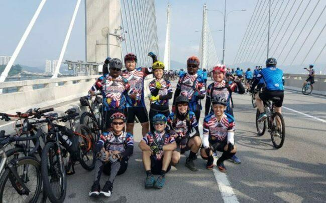 Riding on Penang bridge as feature image for cycling routes in Malaysia