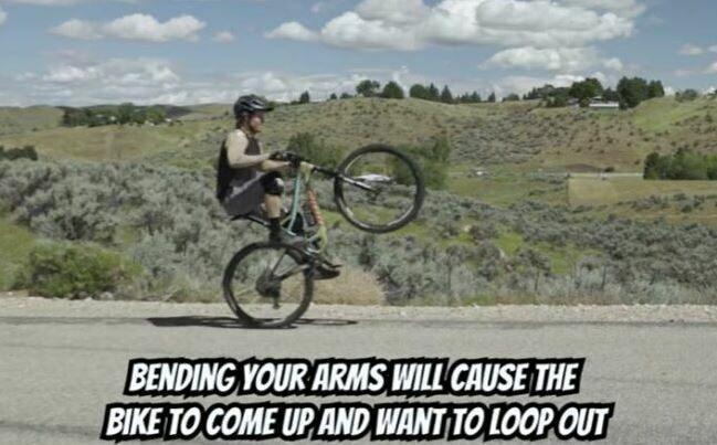 A poor wheelie posture - bending your arms