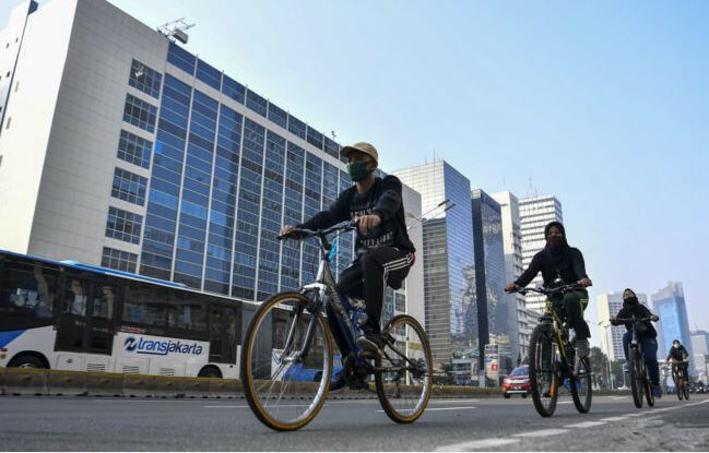 Pandemic cycling brings green hope to Jakarta as the featured image for ANCHEER 26 Electric City Bike.