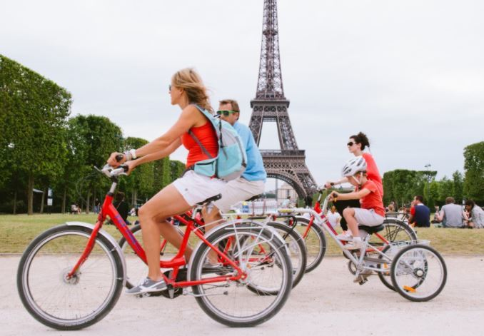Biking in Paris as the featured image for EUNORAU Folding Fat Tire E-Bike Post.