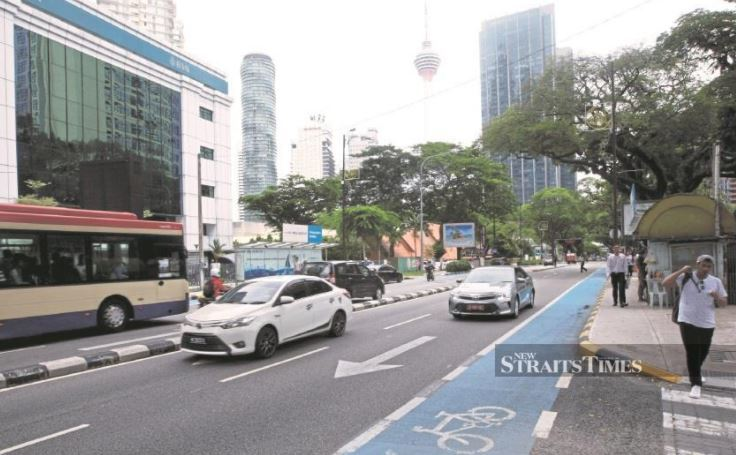 Image from New Strait Times Malaysia - No longer feeling blue about KL's blue bicycle lane.