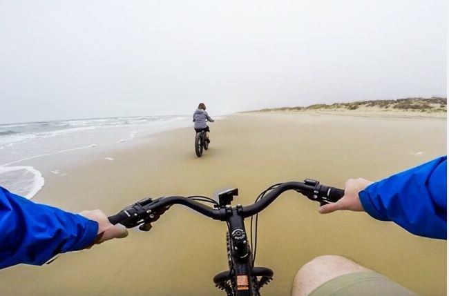 Biking in beach as the featured image for Model R Step-Through Cruiser Post.