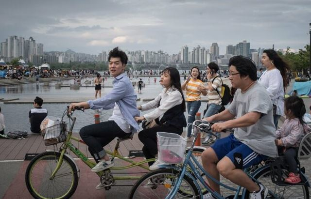 Biking in Seoul as the featured image for RIZE Blade - the best affordable class 3 electric bike post.