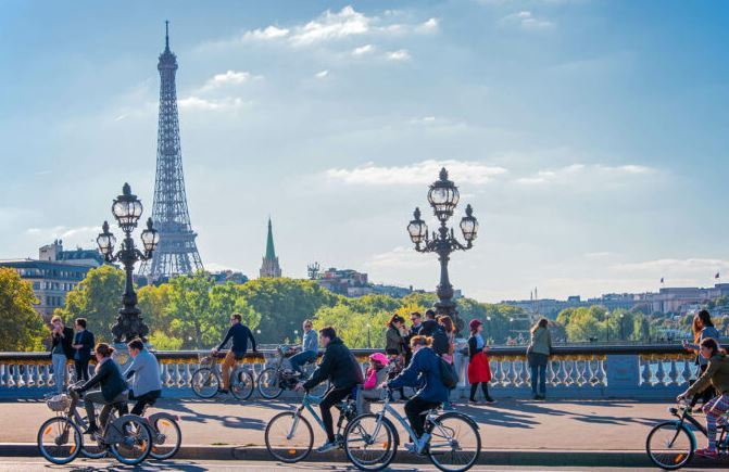 Paris City Riding as the featured image for Van Moof X3 - The Best Affordable Premium Electric bike.